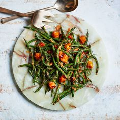 Blistered Green Beans with Tomato-Almond Pesto — This kicky sauce, inspired by Spanish romesco, uses cherry tomatoes.