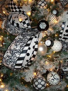 """Black & White tree. I like this idea. Now I know, I know, some people arent too fond of christmas trees due to it once being """"bad"""" however I believe anything once bad can turn good. You dont treat a bad person who turned good, bad forever. Right?"""