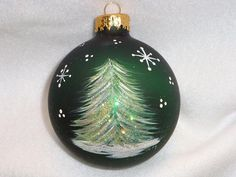 Done on a dark emerald color ornament, adorned with extra fine white glitter. Simple yet elegant. Handpainted Christmas Ornaments, Hand Painted Ornaments, Christmas Ornaments To Make, Xmas Crafts, Diy Christmas Gifts, Christmas Art, Christmas Tree Decorations, Elegant Christmas, Ball Ornaments
