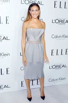 October 15, 2012  She arrives at the 19th Annual ELLE Women in Hollywood celebration in a strapless gray cocktail dress by Calvin Klein Collection and Manolo Blahnik pumps.
