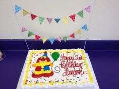 Inexpensive costco clown cake for Gymboree birthday party.