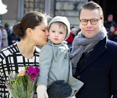 HRH CRown Princess Victoria snuggles daughter Princess Estelle who is held by Prince Daniel of Sweden 3/12/2014