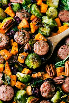 An easy one pan meal -- harvest herb-seasoned sausage and veggies baked together and topped with dried cranberries and pecans. Delicious, hearty, and healthy! via chelseasmessyapron.com