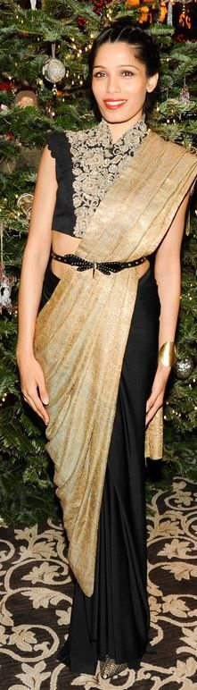 Who made Frieda Pinto's gold and black sari gown that she wore on December 15, 2013?