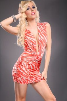 Very sexy figure flattering dress features: Deep V neckline, zebra print, textured, gather front detail, and ruched sides. Polyester/Spandex $27.99