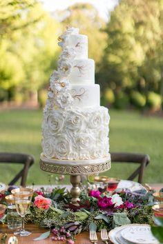 elegant gold and ivory cake - photo by J.Ashley Photography http://ruffledblog.com/wedding-elegance-at-bisham-manor #weddingcake #cakes