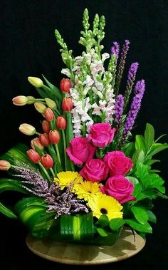 Floral arrangement with gerbera daisies, liatris, snapdragons, tulips, and Heather. Arrangements Ikebana, Large Flower Arrangements, Funeral Flower Arrangements, Large Flowers, Exotic Flowers, Flower Centerpieces, Amazing Flowers, Silk Flowers, Flower Decorations