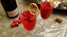 Kerstcocktail van cranberry's en champagne