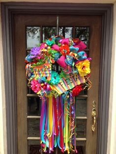"DIY Viva Fiesta and Cinco De Mayo Wreath- Pinned must be from San Antonio,Tx cause we have ""Fiesta Week"" every year!  Way to go!   Beautiful colorful wreath!"