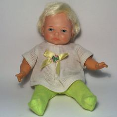 Baby Thumbelina pull-string doll.  Mine has red pants.  I got her in 1968.  $56 for this one on eBay, this is the only toy from my childhood that I still have, and I'm not selling.