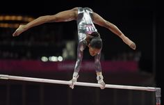 U.S. gymnast Gabrielle Douglas performs on the uneven bars during the artistic gymnastics women's apparatus finals at the 2012 Summer Olympics, Monday, Aug. 6, 2012, in London.