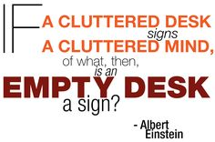 Cluttered desk. Einstein quote