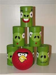 Angry Bird Game.  Paint cans green and decorate with paper and markers. Decorate a small red ball to look like the red bird. Play like bowling, but throw the ball.