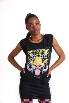 LONG LENGTH TUNIC TIGER T-SHIRT R 285.00 - Stretch t-shirt material - Long length - Round neckline - Sleeveless - Pockets - Tiger graphic on front Tiger T Shirt, Tees, Shirts, Neckline, Tunic, Pockets, Collection, Women, Fashion