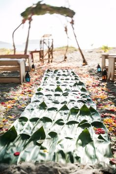 Weddings Costa Rica -This aisle made of DIY woven leaves is such an amazing idea for any beach wedding.
