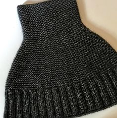 Simple and stylish, GETTING WARMER is a light and cozy cowl worked from the bottom up, transitioning from rib to garter stitch in the round with regular decreases. It can be pulled down over on… Knitted Cape, Knitted Shawls, Knit Vest Pattern, Boucle Yarn, Techniques Couture, How To Get Warm, Sock Yarn, Garter Stitch, Crochet Accessories