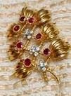 From Her Majesty's Jewel Vault: The Ruby and Gold Flower Brooch, wedding gift from the Principality of Monaco.