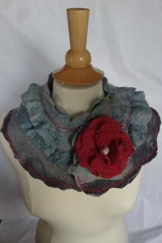 Felted neck wrap in blue grey and grey with 2 ruffled layers comes with the flower pin which matches the machine embroidery.Original design and as I
