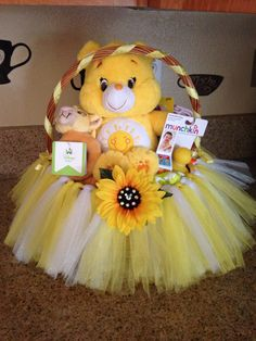 Funshine Bear care bear sunshine tulle basket (with hidden Mickey) Gift basket… Theme Baskets, Baby Baskets, Baby Shower Gift Basket, Baby Shower Gifts, Corporate Gift Baskets, Diy Gift Baskets, Christmas Gift Baskets, Hidden Mickey, Baby Girl Gifts