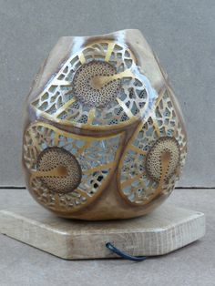 Unique, one of a kind gourd art with two faces, ambiental gourd lamp with a motif of heart and branching, which symbolizes the growth of…