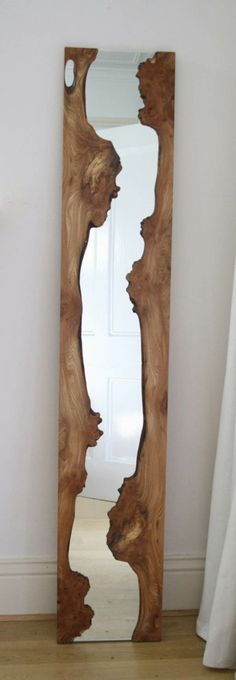 Mirror with raw wooden frame