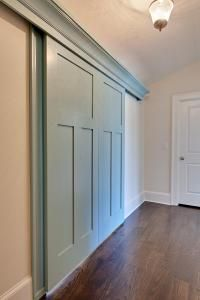 barn style doors leading to the kids play room on the second floor.