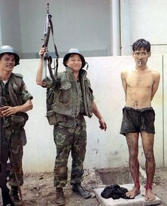 Vietnam War    South Vietnamese soldiers show off a Viet Cong prisoner captured near Tan Son Nhut Airbase. May 6, 1968