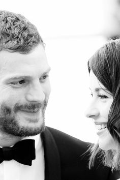 Look how he looks at his wife. <3 (Jamie and Ameila Dornan)