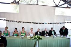 Head table with personal photos behind them