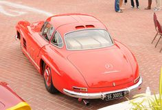 touring in a red Mercedes