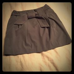 Banana Republic Skirt Wonderful business casual to formal skirt. Blue/Gray toned with tie front and zipper back. Banana Republic Skirts