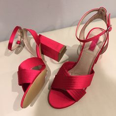 Style up your look with these eye-catching pink sandals. Crafted from luxurious satin and featuring a cross strap and interest heel, these shoes exude modern glamour. #Topshop