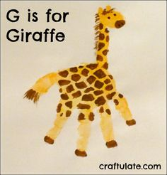 G is for Giraffe. This giraffe was made with a yellow-orange handprint, then neck and head added. After the paint had dried I added brown spots, mane, and eyes.