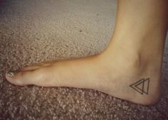 sparkly toenails and triangle tattoo