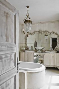 Love the mirror,vanity and chandelier...very beautiful rich relaxing bathroom