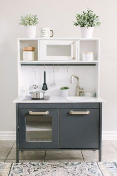 Navy and white ikea play kitchen with marble worktops