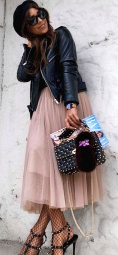 #spring #outfits  woman wearing black leather jacket holding bgag. Pic by @_luxury_fashion_style