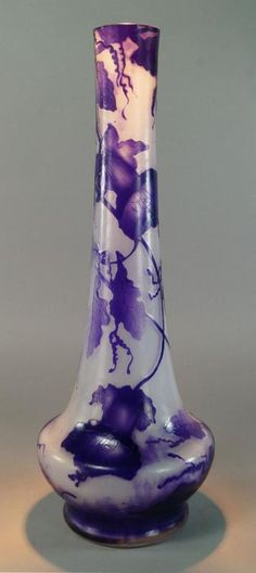 A Gallé tall cameo glass vase, with purple flowering vine design, etched Galle signature, approx 43cm high. - Price Estimate: £800 - £1200