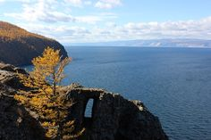 The wishful window on Olkhon Island - Lake Baikal. Legend has it you have to make a wish into the window (into the wind) for it to come true. and it was Very Windy. Lake Baikal Russia, Planets, Window, Tours, Island, Day, Water, Travel, Outdoor