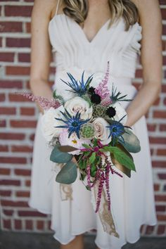 unusual bouquet with lots of texture, too big, unstructured overpowers the dress  | B. Mo Foto #wedding
