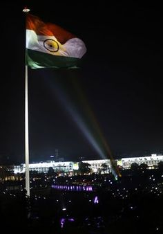 Lights are aimed at a giant flag of India unfurled earlier in the day in New Delhi. Indian Tiranga, Indian Flag Pic, Indian Flag Images, Indian Flag Wallpaper, Indian Army Wallpapers, Navy Wallpaper, Independence Day Background, Independence Day Wallpaper, Independence Day India