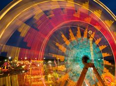 The Ferris wheel at the Kansas State Fair in Hutchinson mimics a giant Lite-Brite toy. Long lines can form at popular midway rides, but in this long exposure all the stress melts away.