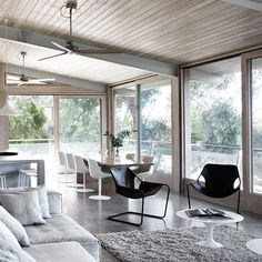 The modern Rob Mills aesthetic in its purest essence Ocean House is a study in harmony. Raw concrete and polished timber blend seamlessly with the forest to create a calming retreat. We love the styling of the Paulistano Chair from Objekto Marley by @lowefurniture Flow Chairs from MDF Italia Viccarbe Last Minute Stools in the space. Photo by @ShannonMcGrath7 #hubfurniture #australian #architecture #design #furniture by hub_furniture