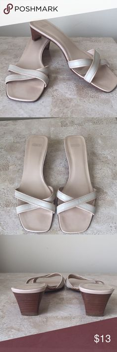 Coach low heel sandals Dainty criss-cross straps. Low wood type heels. Please note all photo angles for exact condition. Priced accordingly. Coach Shoes Sandals