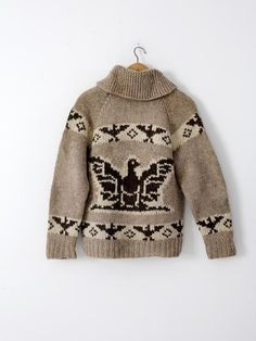 A vintage hand-knit cowichan sweater. The thick wool sweater features a thunderbird eagle pattern in natural wool tones and a zipper closure. - cowichan sweater - zip up closure cardigan - thick wool Fair Isle Knitting, Hand Knitting, Knitting Patterns, Cowichan Sweater, Chunky Cardigan, Sweater Making, Cool Sweaters, Knit Jacket, Knitwear