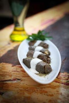 Dolmades and Dolmadakia (small stuffed grape leaves..) wonderful in any combination..