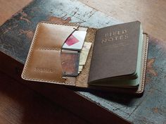 A handcrafted and hand stitched leather Field Notes cover. Made from high quality tan Latigo leather by legendary Horween factory.  Left side has 1 large