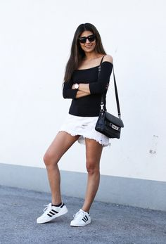 The simplest of outfits  Black off-the-shoulder top paired with a white 8a88a40235588