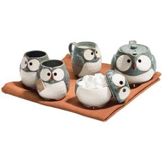 Who's got the cutest tea set? That would be you, with this whimsical owl teapot and two matching cups, with matching creamer and sugar. Quality is evident in the set's detailing which features a textured stoneware exterior that adds to the natural beauty of the pieces.DetailsMaterialStonewareCare InstructionsNot dishwasher safe. Do not microwave.Country of OriginJapan