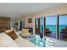 Ocean front penthouse living room with stunning views of the Gulf of Mexico.  14th floor of the Horizon House building.  Park Shore | Naples, Florida